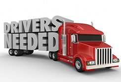 Truck with the words drivers needed on the side