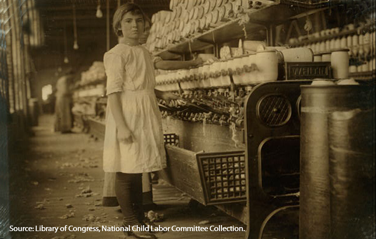 Young girl working at spooling room in the Brazos Valley Cotton Mill, West, Texas, about 1913.